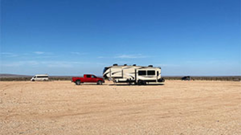 A 5th wheel camper boondocking in New Mexico