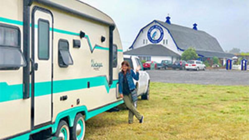 Woman and her RV camping at Tillamook