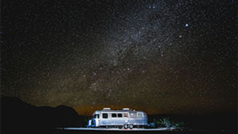 Airstream camping under the milky way.