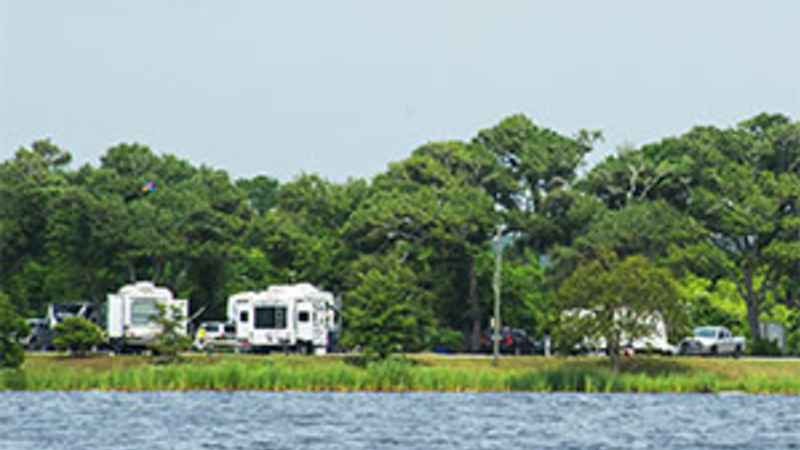 RV's camping by the water at a state park