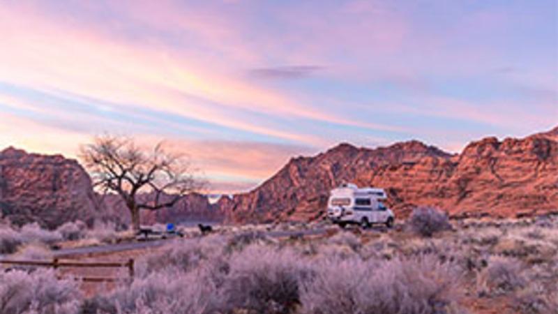 An RV camping at sunset in Utah